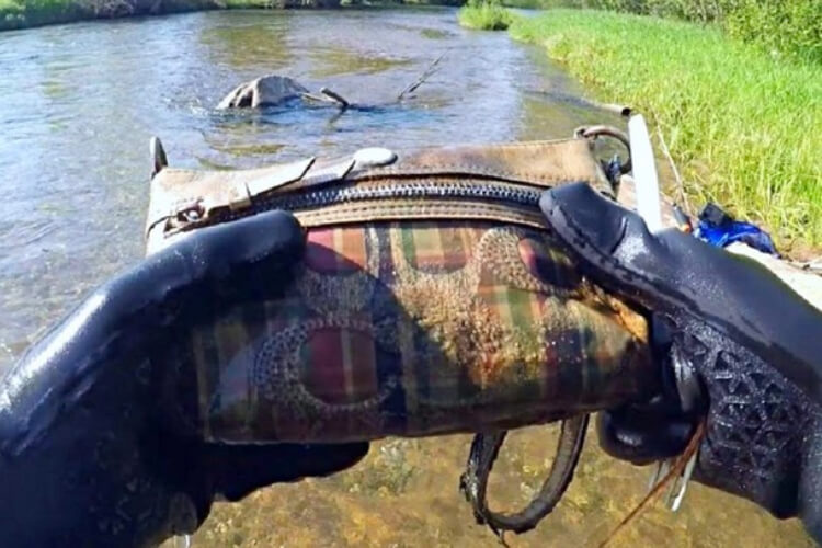 Young Boy Finds Underwater Purse In Lake
