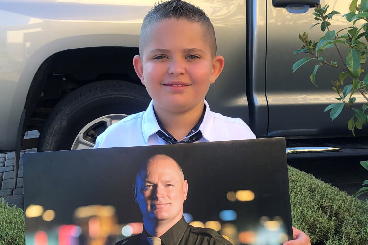 Police Officers Surprise Late Colleague's Son