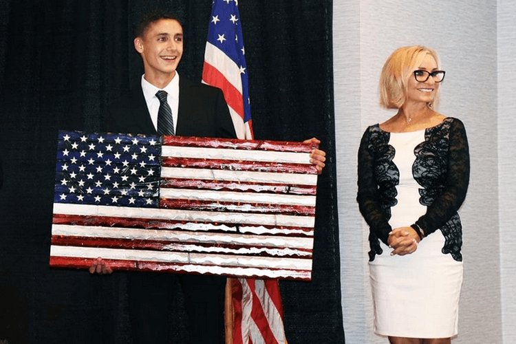 Teenager Carves Wooden Flags For Veterans